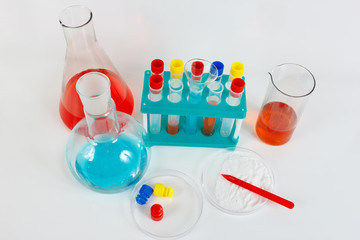 Tools and equipment for pharmaceutical research on a white background