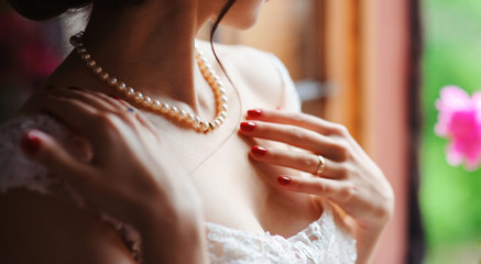 bride and wedding concept - beautiful woman with diamond engagement ring close up macro