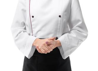 Female chef in uniform on white background, closeup