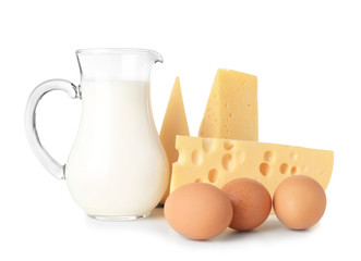 Dairy products and eggs on white background