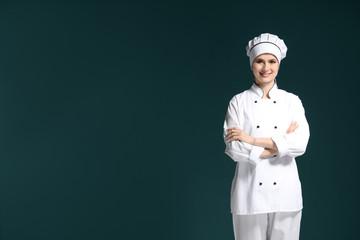 Female chef in uniform on dark background