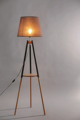 Elegant floor lamp on grey background