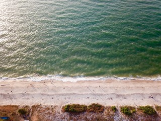 Aerial photography by a drone. Closeup of beach and sand from the top view or air. Crop fragment.