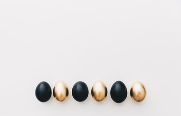 Black and gold eggs. Minimal easter background