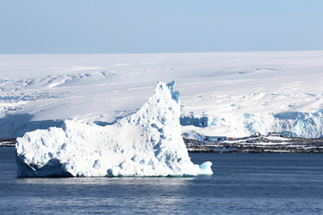 Antarctica on a Sunny day- Antarctic Peninsula - Huge Icebergs and blue sky