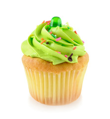Green cupcake isolated on white background