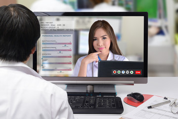 Wall Mural - Female doctor discussed on patient medication by interactive video conference.