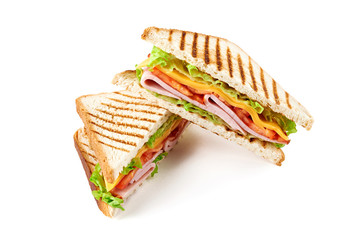 Acrylic Prints Snack Sandwich with ham, cheese, tomatoes, lettuce, and toasted bread. Above view isolated on white background.