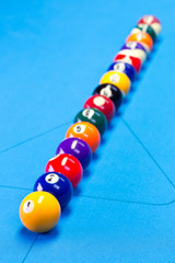 Billiard pool game balls lined up on billiard table