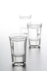 German hard liquor Korn Schnapps in shot glasses