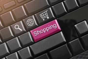 Shopping text on a black computer keyboard for design.