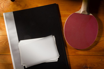 Folder with photos and tennis racket
