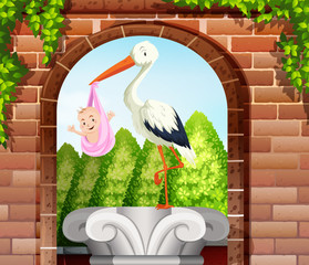 Baby wrapped in pink cloth and bird in garden