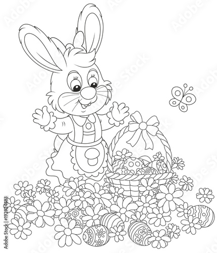 Easter egg hunt in flowers. Little bunny with a decorated ...