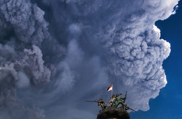 Ash from Mount Sinabung volcano rises to an approximate height of 5,000 meters during an eruption as seen from Brastagi town in Karo