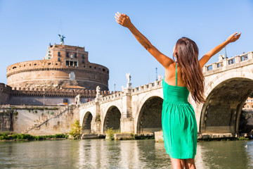 Wall Mural - Rome travel tourist girl happy with arms up in freedom at Castel Sant'Angelo, popular attraction. Happy woman sightseeing at roman castle of Angels enjoying summer holidays travel in Italy, Europe.