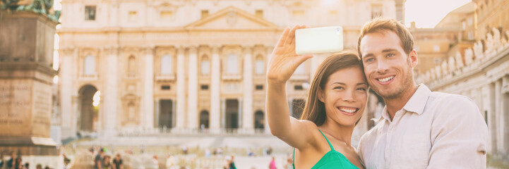 Wall Mural - Rome tourists on honeymoon vacation taking selfie photo with phone in front of Vatican, banner panorama horizontal crop. Couple in love on summer holiday, europe travel.