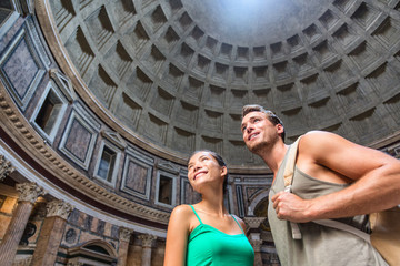 Tourists visiting the Pantheon in Rome. Former Roman temple, now a church. Young couple sightseeing in italy, Europe summer travel vacation.