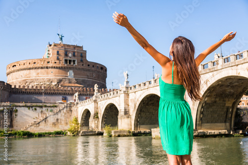 Wall mural Rome travel tourist girl happy with arms up in freedom at Castel Sant'Angelo, popular attraction. Happy woman sightseeing at roman castle of Angels enjoying summer holidays travel in Italy, Europe.