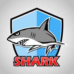 Cartoon shark with blue shield