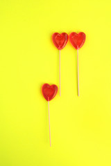 Composition of lollipops in the shape of a heart about the suffering of one