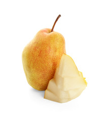 Delicious whole and sliced ripe pears on white background