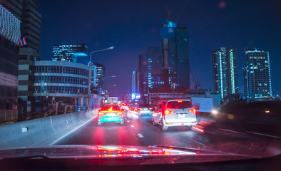 Traffic light at night in Bangkok, Blurred background