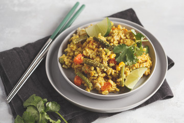 Vegetarian curry rice with vegetables in a gray plate.  Healthy vegan food concept, detox, vegetable diet.