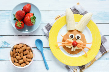 Healthy Easter Breakfast For Kids. Easter Bunny Shaped Pancake With Fruits. Top View