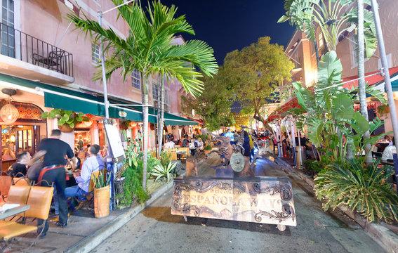 MIAMI - FEBRUARY 25, 2016: Tourists along Espanola Way on a beautiful winter night. Miami Beach is a famous tourist attraction