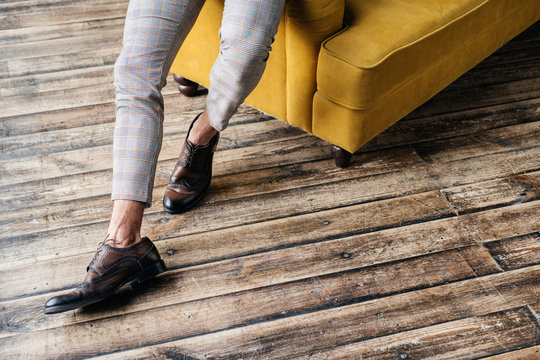cropped view of elegant stylish man in brogue shoes