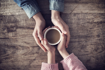 Lover holding coffee cup