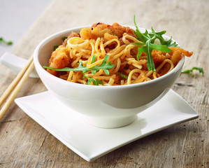 Bowl of asian noodles with fried meat