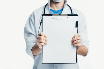 A doctor holds a blank sign on a clipboard ready to add your message on white background