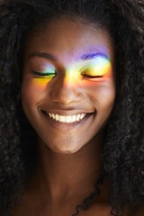 Rainbow over eyes of beautiful smiling woman