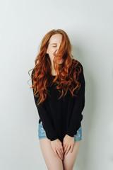 Vivacious young redhead woman laughing