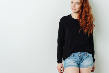 Attractive redhead woman with a skeptical look