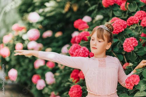 d6d36b191 Little ballerina girl dancing in hydrangea garden