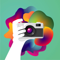 Creative photo art. Hand is holding a camera. Vector illustration.