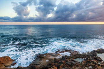 fantastic stunning colorful landscape, sunset on the shore of the blue sea, the coast of Cyprus, the neighborhood of Paphos
