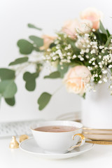 Blush wedding bouquet with roses and cup of tea. Portrait. Soft focus. Small depth