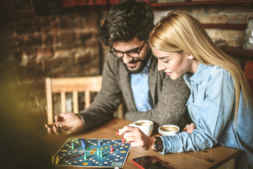 Young couple playing leisure games together.