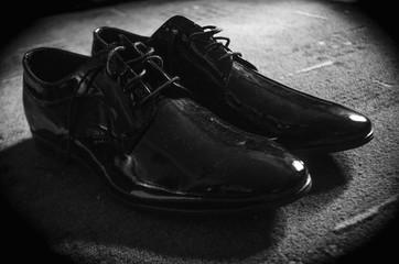 Close-up young man tying elegant shoes indoors, shoe, male, leather,