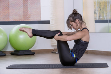 Pilates teacher, doing an exercise