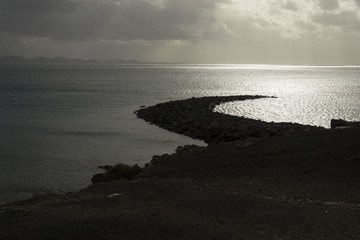 Spit of land jutting out into the sea Playa Blanca, Lanzarote, Canary Islands, Spain