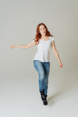 Cute playful young redhead woman