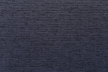 Close-up of a black furniture fabric texture background.