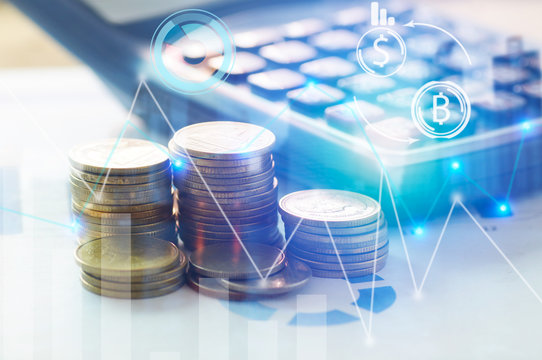 Finance, profit, capital banking and investment concept, Double exporsure stacked of coins and night city with graph.