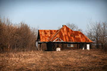 old wooden house with sheet metal roof