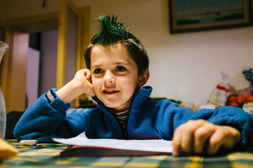 portrait of 9 year old baby boy with crest of green colored hair